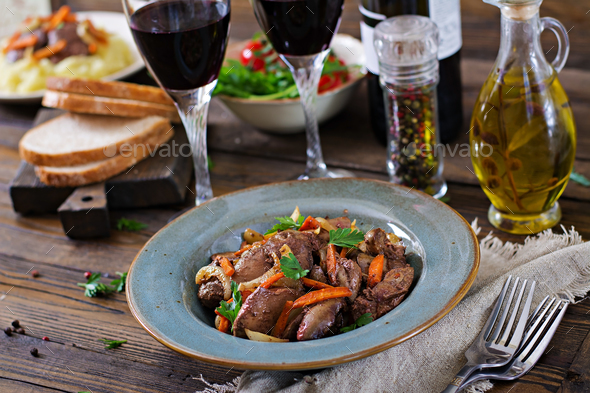 Fried chicken liver with vegetables. Healthy food. - Stock Photo - Images