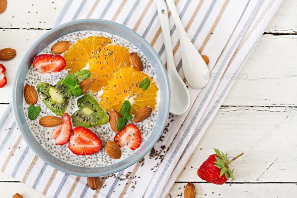 Vegan almond milk chia seeds pudding with strawberries, orange and  kiwi. - Stock Photo - Images