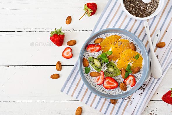 . Vegan almond milk chia seeds pudding with strawberries, orange and  kiwi - Stock Photo - Images