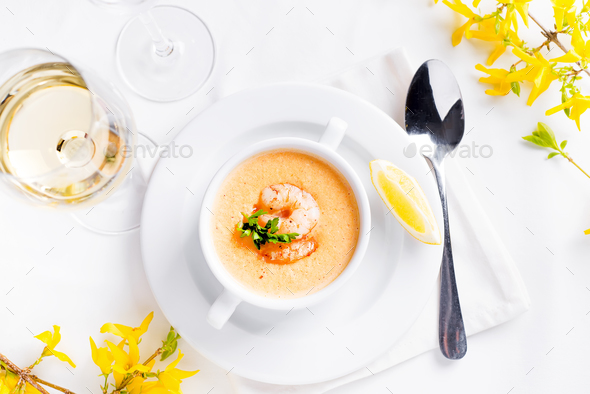 Creamy pumpkin soup with seafood and lemon on a white background. - Stock Photo - Images