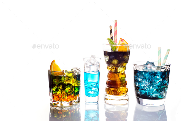 Selection of colorful festive drinks, alcoholic beverages and cocktails in elegant glasses on white - Stock Photo - Images