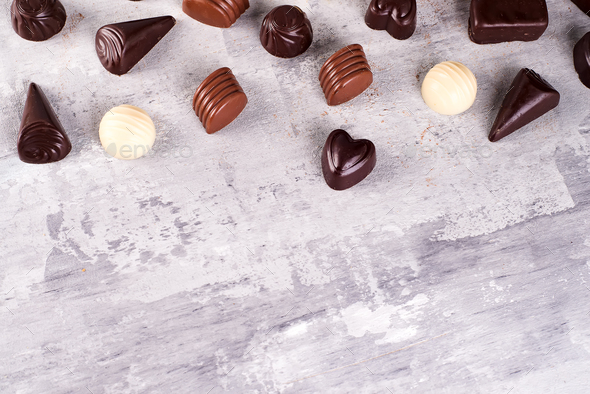 Border pattern of photos assortment of chocolate candies - Stock Photo - Images