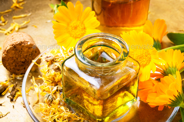 Medicine bottle and herbs calendula - Stock Photo - Images