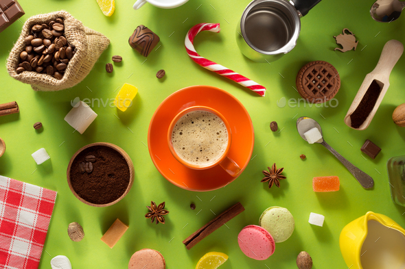 cup of coffee and ingredients at colorful background - Stock Photo - Images