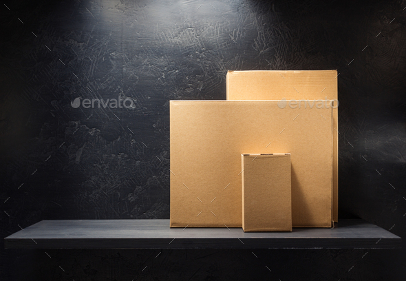 cardboard box on wooden shelf - Stock Photo - Images