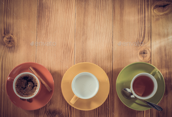cup of tea, milk, coffee on wood - Stock Photo - Images