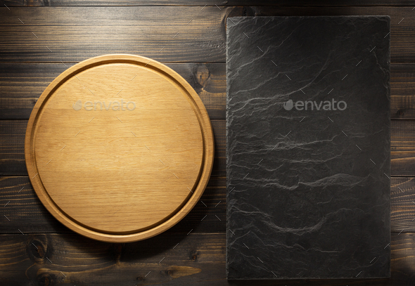 pizza cutting board at brown background - Stock Photo - Images