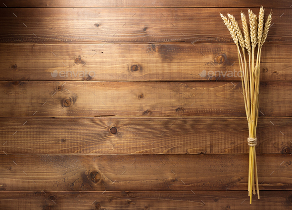 ears of wheat on wooden background - Stock Photo - Images