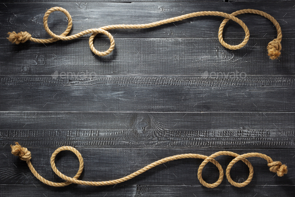 ship rope at wooden background - Stock Photo - Images