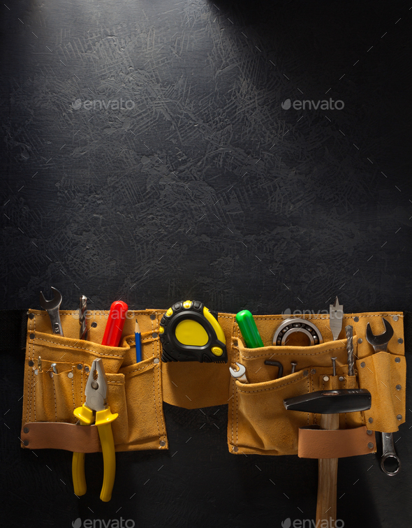 tools and instruments in belt on black - Stock Photo - Images