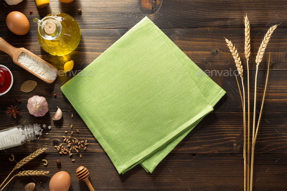 ears of wheat and bakery ingredients on wood - Stock Photo - Images