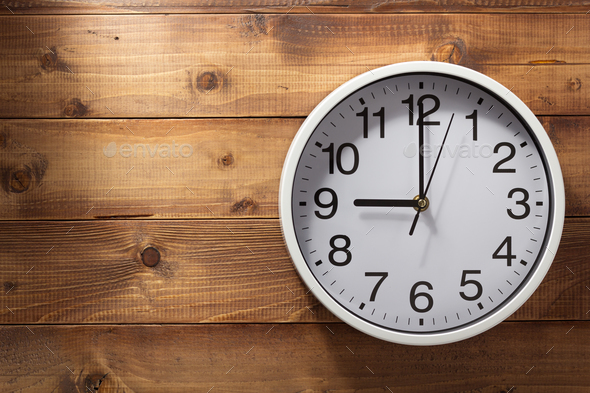 wall clock at wooden background - Stock Photo - Images