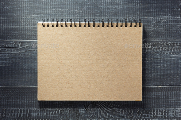 notebook at wooden  background - Stock Photo - Images