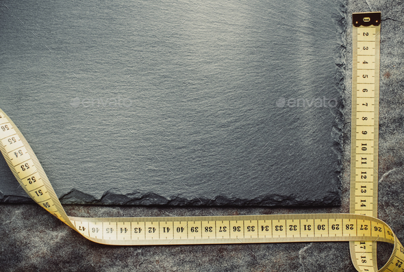 measuring tape on table - Stock Photo - Images