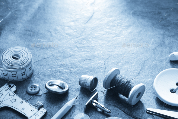 sewing tools and accessories on table - Stock Photo - Images