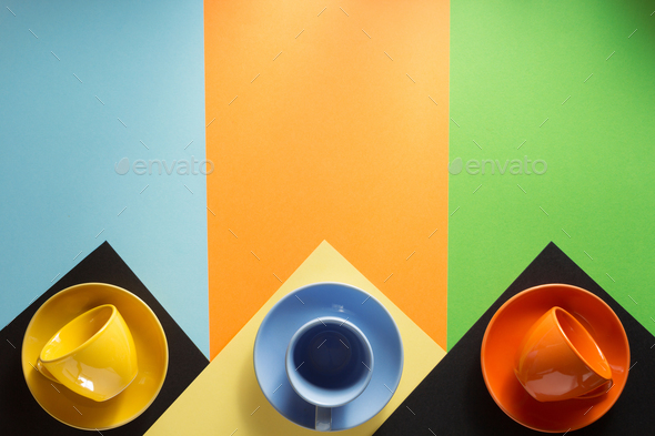 cup and saucer at colorful background - Stock Photo - Images