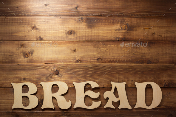 bread letters on wooden background - Stock Photo - Images
