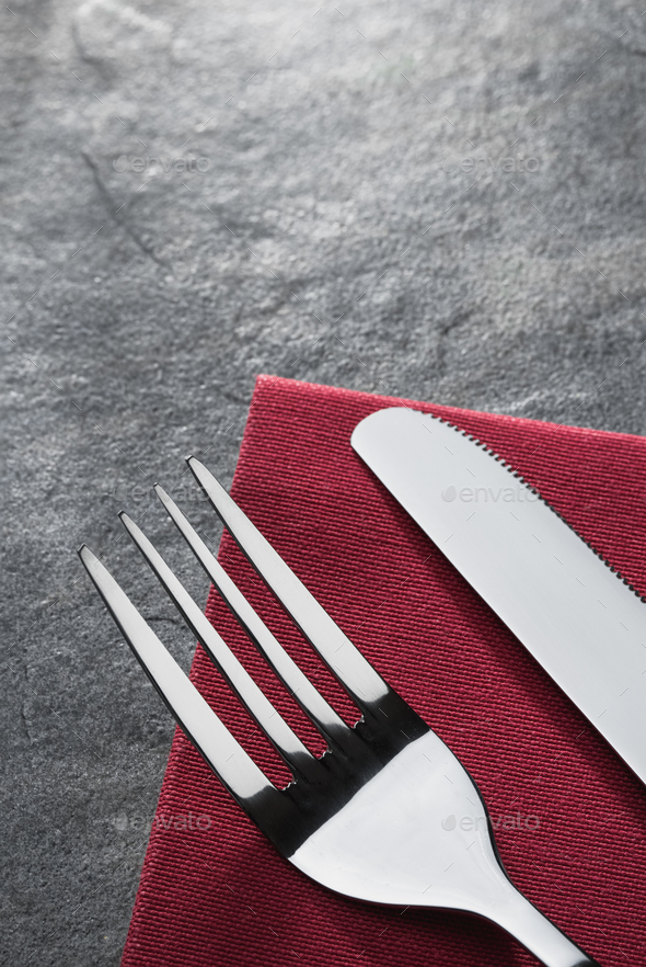 knife and fork on napkin - Stock Photo - Images