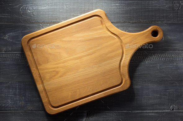 cutting board at wood background - Stock Photo - Images