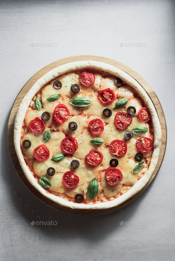 italian pizza at table surface - Stock Photo - Images