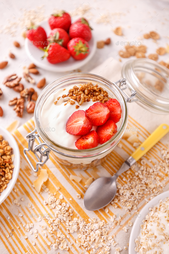 Glass jar of oat granola - Stock Photo - Images