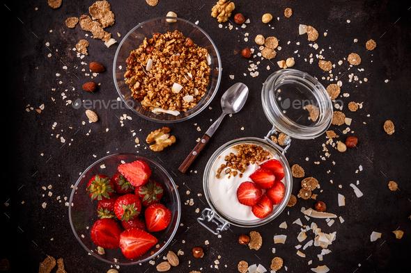 Tasty granola with yogurt - Stock Photo - Images
