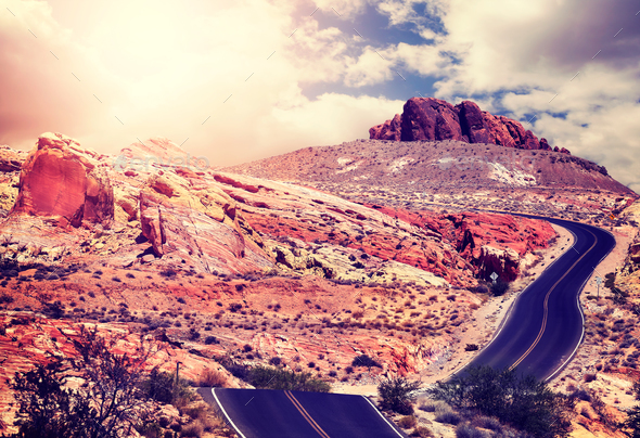 Vintage toned picture of a desert road at sunset. - Stock Photo - Images