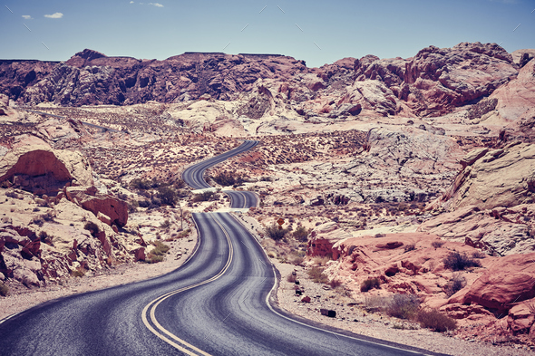Vintage toned picture of a winding desert road. - Stock Photo - Images