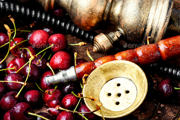 Stylish oriental shisha with cherries - Stock Photo - Images