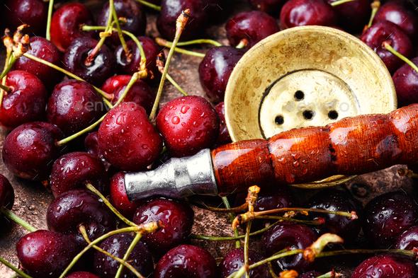 Stylish oriental shisha with cherries - Stock Photo - Images