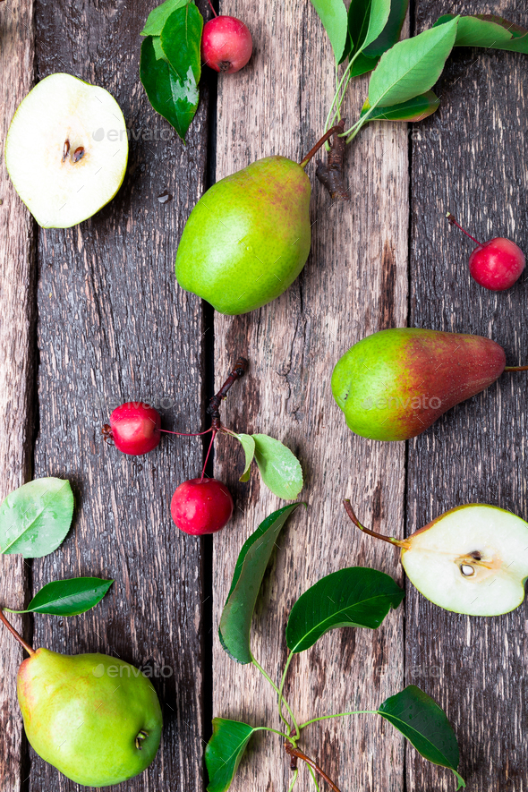 Pear and small apple on wooden rustic background. - Stock Photo - Images