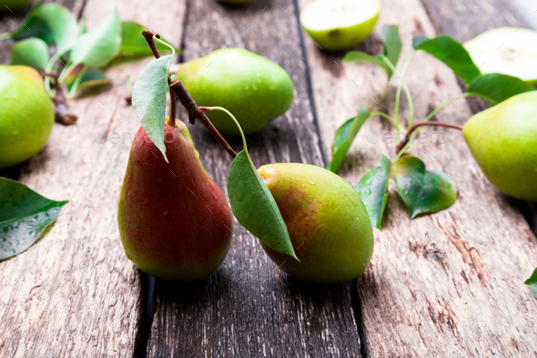 Pear on wooden rustic background. - Stock Photo - Images