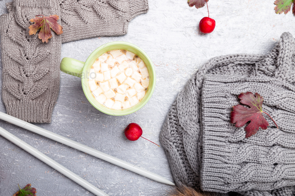 Grey knitting gloves, scarf, hat and needles - Stock Photo - Images