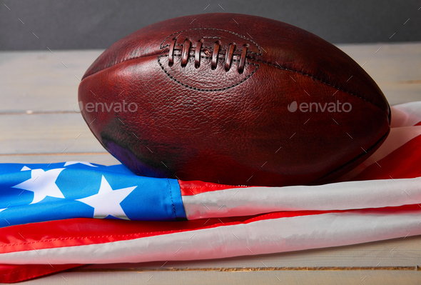 American football ball and old glory flag - Stock Photo - Images