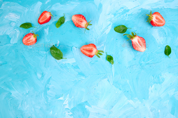 Strawberry and basil on blue background - Stock Photo - Images