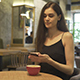 Woman Blogger with Smartphone in Restaurant - VideoHive Item for Sale