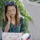 Young Woman Talking on a Mobile As She Works - VideoHive Item for Sale