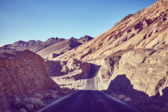 Vintage toned picture of a desert road, USA. - Stock Photo - Images