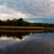 Storm Clouds Moving in Over the Lake at Sunset - VideoHive Item for Sale