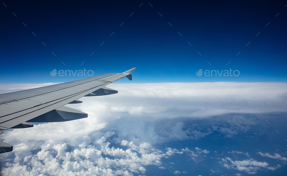 Plane wing on blue sky background - Stock Photo - Images