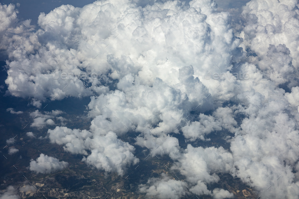 Cloudy sky background. View out of an airplane window. - Stock Photo - Images