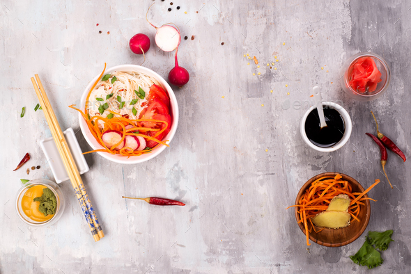 Spicy glass noodles with vegetables - carrots, cucumber, peppers, garlic. - Stock Photo - Images