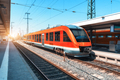 High speed train on the railway station at sunset in summer - PhotoDune Item for Sale