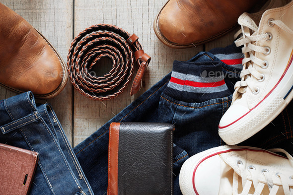 clothing and leather on wooden floor - Stock Photo - Images