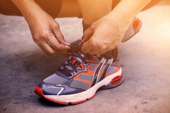 Hands tying shoes for jogging - Stock Photo - Images