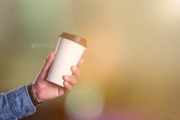Hands holding hot coffee - Stock Photo - Images