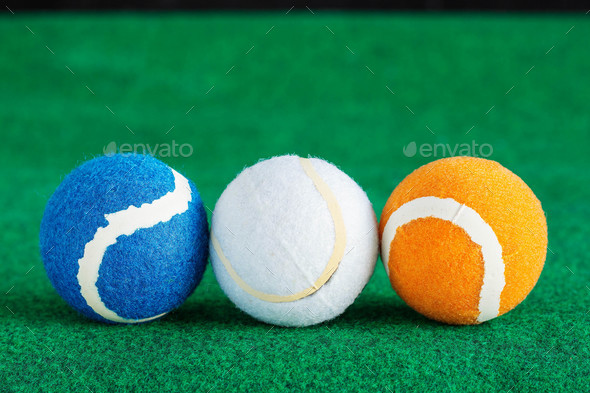 balls placed lined on the lawn - Stock Photo - Images