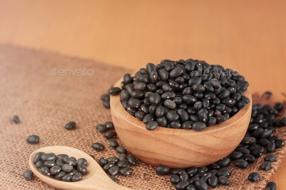 Black beans on wooden - Stock Photo - Images