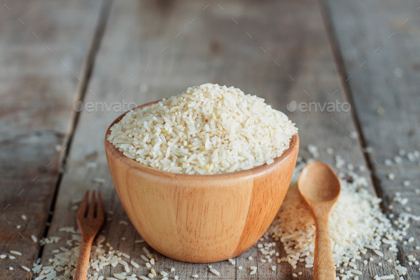 Rice and spoon on wooden - Stock Photo - Images