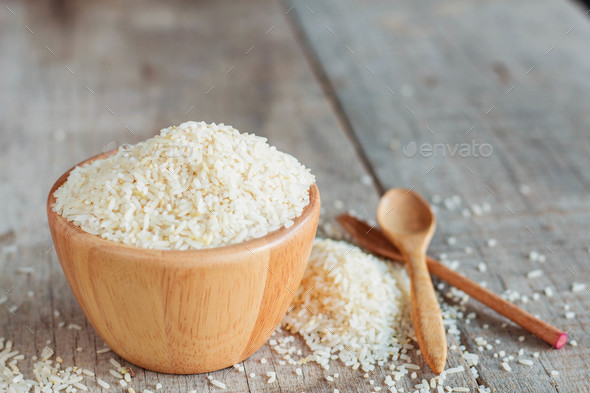 Rice on wooden floor - Stock Photo - Images